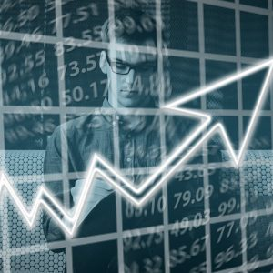 Man with overlayed positive growth line chart
