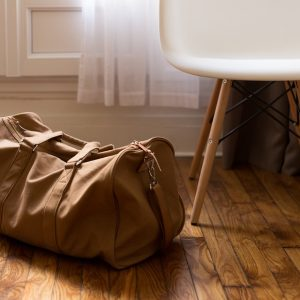 Suitcase on Floor next to Chair