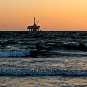 View of ocean with oil rig