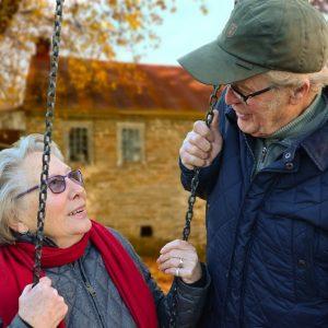 Seniors on Swing Smiling