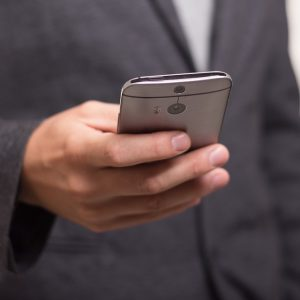 Man in suit holding phone