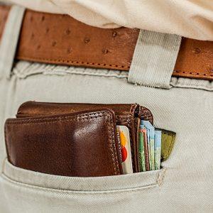 Large wallet sticking out of back pocket
