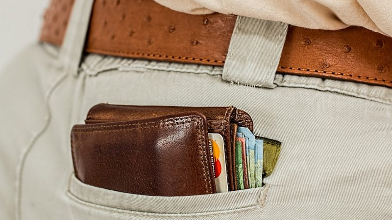 Large wallet sticking out of back pocket