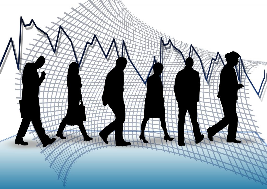 Workforce in front of a fluctuating line graph
